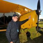 Returned serviceman Mack Swinburn (93), of Waipukurau, prepares for a flight in a Tiger Moth. ...