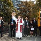 Rev Fr Kevin Toomey blesses the wreaths laid at the base of a Leith Bridge memorial to those who...