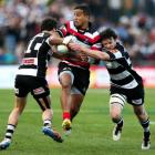 Rey Lee-Lo of Counties Manukau is tackled by Richard Buckman (R) and Zac Guildford of Hawkes Bay...
