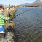 Rhyan Griffiths (5), of Arrowtown, found a new hobby at the Kids' Fishing Day, organised by the...