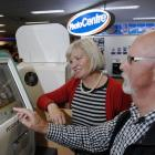 Ria (64) and Gerald Schouten (63), of Balclutha, select family digital photos for printing at...