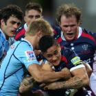 Richard Kingi of the Rebels is tackled during the round two Super Rugby match between the Rebels...