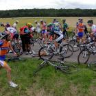 Riders are seen after a fall during the sixth stage of the 99th Tour de France between Epernay...