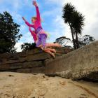 River (5) and Tasman (7) Charteris-Wright jump from steps on to Broad Bay Beach. Photo by Craig...