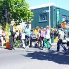 George Street Normal School principal Rod Galloway (left) supervises his pupils as they cross...