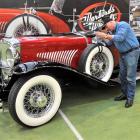 Robert Duncan, of Wanaka, gives his 1934 Duesenberg Le Baron-bodied Sports Phaeton a polish after...