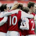 Robin van Persie (10) of Arsenal is congratulated after scoring against Swansea City during their...