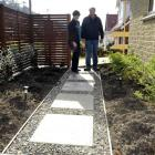 Robyn and Alan Thomson survey the remains of their garden yesterday after 14 plants were stolen...