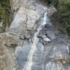 Rocks the size of houses perched above State Highway 6 near Haast, are slowing down clearing of...