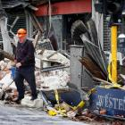 Roger Kelso removes stock from his wrecked Westende Jewellers shop on the corner of Worcester and...