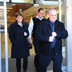 Roger Weatherston (front) is followed out of the High Court at Christchurch by daughter Angela...