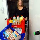 FoodShare manager Pip Wood wheels another load of food from the chiller. The organisation needs...