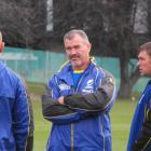 Romania assistant coach and former All Black prop Steve McDowell keeps watch on a training...