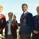 Roncalli College pupils Jordan Hooke (left) and Therese Styles, collect the Bishop Boyle Trophy...