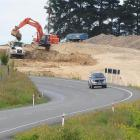 Rooney Earthmoving contractors work on a $1.14 million project to straighten corners on State...
