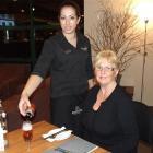 Rosebank Lodge restaurant and function supervisor Monique Rutene pours a drink before Rosebank...