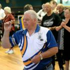 Ross Abernethy prepares to throw a dart in the mixed fours competition at the Otago Darts...