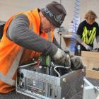Ross Nicolaou (left) and Glen Drinkwater disassemble computers for recycling at Cargill...