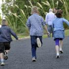 Rotary Park School pupils head for class on the first day back at school yesterday. Photo by...