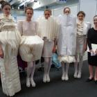 Roxanna Zamani, with models wearing her Incongruous collection, gets ready for judging at the...