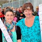 Royal fans Tash Bambry and her mother, Marion Long, both of Dunedin, show off the tickets they...