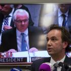 Russia's permanent representative to the United Nations Vitaly Churkin (on the screen) presides...