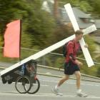 Ryan Craig of Oamaru carrying his cross. Photo by Peter McIntosh.
