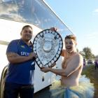 Ryan Hammer (23) is rewarded for his attempts to get close to the players and the Ranfurly Shield...