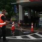 S.J. Allen Wakatipu waste disposal owner Simon Spark hoses down the Queenstown KFC drive-through...