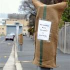 Sacks that appeared on parking meters and lights in the city yesterday, with messages critical of...