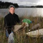 Saddle Hill Community Board chairman Keith McFadyen displays rubbish found in the Kaikorai...