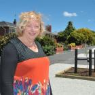 Saddle Hill Community Board deputy chairwoman Pam Jemmett admires the new landscaping in November...