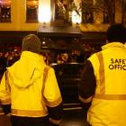 Saftey Patrol officers Pat Wall (left) and Grahame Fox watch closely as the crowd grows in the...