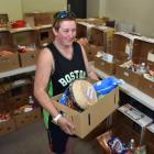 Salvation Army Dunedin volunteer Mel Carter with a Christmas hamper for an individual. Photos by...
