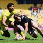 Sam Dickson of New Zealand dives over to score a try during the match between New Zealand and...
