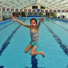 Samantha Kirkman (10) dives into the Port Chalmers Pool during a community gathering yesterday to...