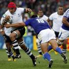 Samoa's Paul Williams attempts to tackle Fiji's Netani Edward Talei. REUTERS/Nigel Marple