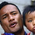 Samoan rugby player Eliota Fuimaono Sapolu talks to the media as he arrives at a disciplinary...