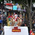 Santa Claus makes an early visit to Dunedin for yesterday's Santa Parade. Photo by Christine O...