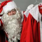 Santa prepares for the up-coming Christmas season by sorting out his helper's costumes. Photo by...