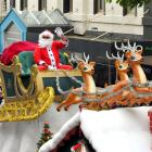 Santa waves to the crowd during the Parade. Photo by Gregor Richardson.