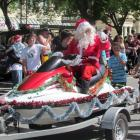 Santa, with a jet ski for a sleigh, at the Oamaru Santa Parade on Saturday. Photo by Ben Guild.