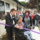 Sara Cohen School pupil Karena Robinson officially opens the school's refurbished administration...