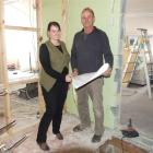 Sarah and Ross, the father and daughter team from Ross Andrew Builders, look over plans on one of...
