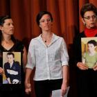 Sarah Shourd (centre), stands with Cindy Hickey (left), mother of Shane Bauer, and Laura Fattal,...