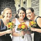 Sarah, who married Royce Warren in Dunedin, with her attendants. McROBIE PHOTOGRAPHICS