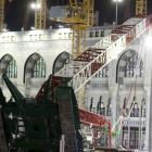 Saudi emergency crew stand near a construction crane after it crashed in the Grand Mosque in the...