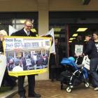 Save Dunedin Metro Post Shop and Kiwibank campaign spokesman Victor Billot prepares to send a...