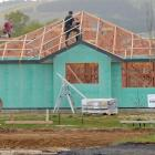 Scaffolders work on a house in the Highland Park subdivision in Mosgiel.  Photo by Stephen Jaquiery.