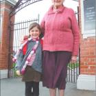 School mates: Abbey Collins (4) is held close by her greatgrandmother Thelma Howison, who...